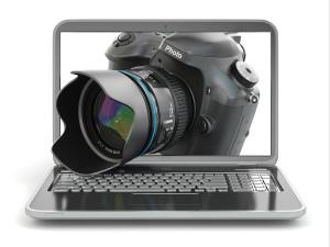 Digital photo camera and laptop. Journalist or traveler equipm